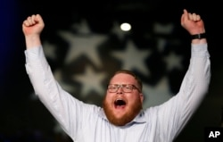Reid Sheldahl of Des Moines, Iowa, cheers as Democratic presidential candidate Sen. Bernie Sanders, I-Vt., speaks during the Iowa Democratic Party's Jefferson-Jackson fundraising dinner, in Des Moines, Iowa, Oct. 24, 2015.