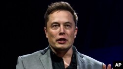 FILE - Elon Musk, CEO of Tesla Motors, unveils the company's newest products in Hawthorne, California, April 30, 2015.
