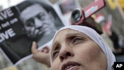 Demonstrators during a demonstration near the UN headquarters in New York against Egyptian President Hosni Mubarak, January 29, 2011
