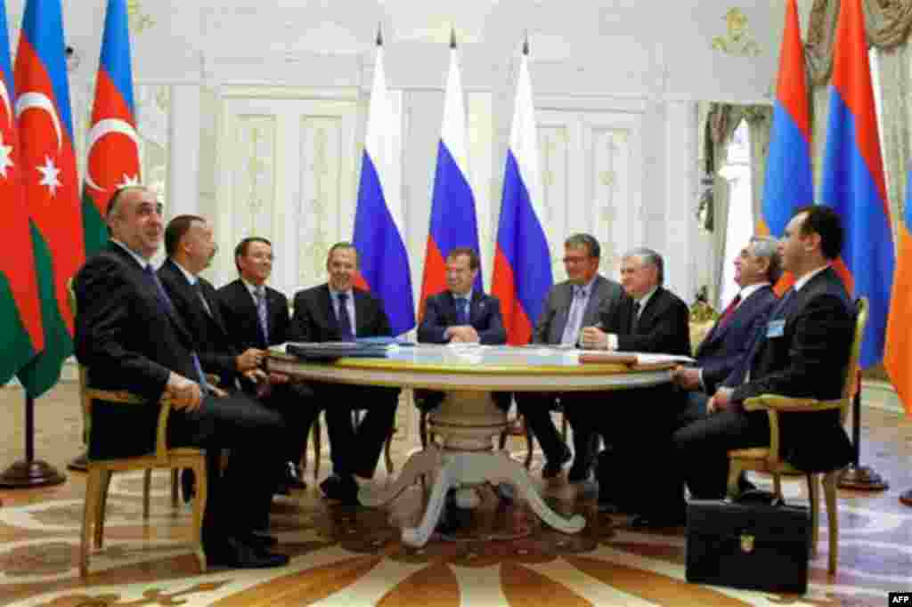 Russian President Dmitry Medvedev, center, Armenian President Serge Sarkisian, second right, and Azerbaijan's President Ilham Aliyev, second left, seen during their meeting in the presidential palace of the Kremlin in Kazan, about 700 kilometers (450 mile