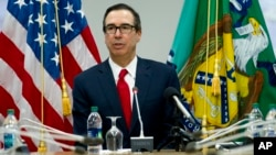 Treasury Secretary Steve Mnuchin speaks during a news conference at World Bank/IMF Spring Meetings, in Washington, April 21, 2018.