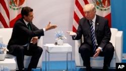 El presidente de EE.UU., Donald Trump y su homólogo de México, Enrique Peña Nieto, se reúnen en privado en el marco de la Cumbre del G-20.