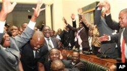 Zimbabwe's Movement for Democratic Change members of parliament celebrate the victory of Lovemore Moyo, center, who won the most votes in an election to determine the next speaker of the country's Parliament, in Harare, Tuesday, March, 29, 2011.