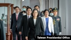 Taiwanese President Tsai Ing-wen, center, walks ahead of Vice-President Lai Ching-te, left of her, as they attend an inauguration ceremony in Taipei, Taiwan, Wednesday, May 20, 2020.