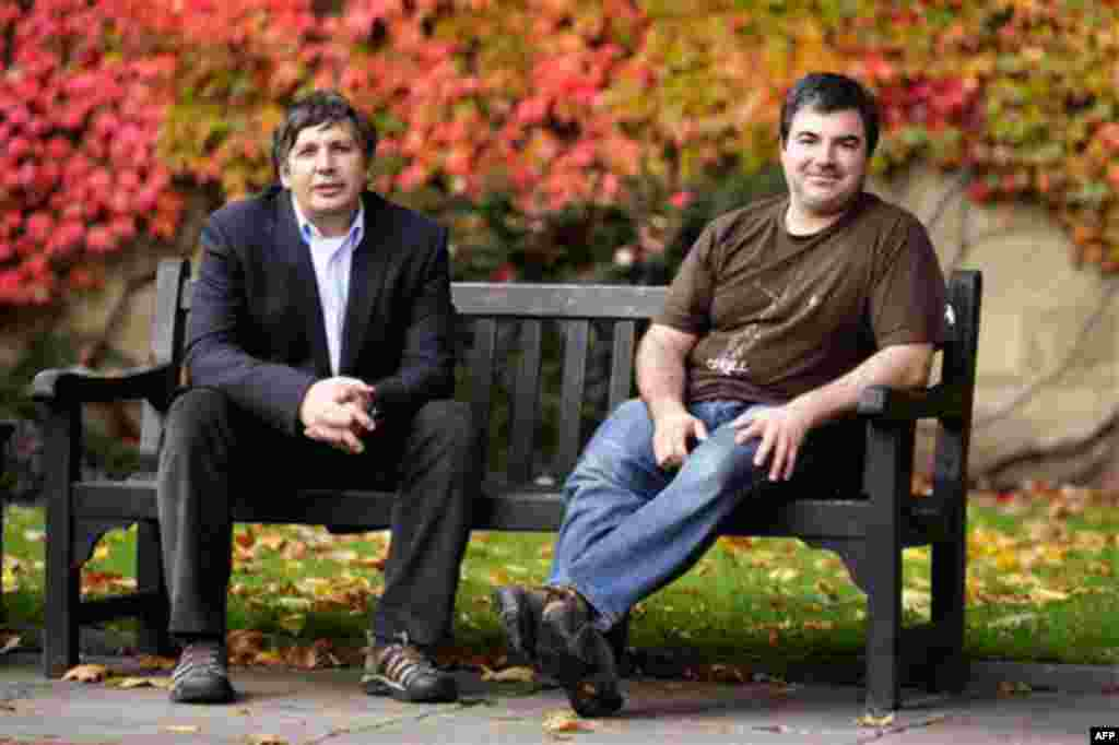 Professor Andre Geim, left, and Dr Konstantin Novoselov who have have been awarded the Nobel Prize for Physics pose for pictures outside Manchester University, Manchester, England, Tuesday, Oct, 5, 2010. The scientists shared the Nobel Prize in physics