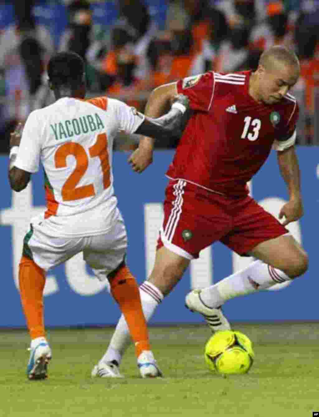 Morocco's Houssine Kharja (13) dribbles the ball against Niger's Seydou Ali Yacouba (21) during their final African Cup of Nations Group C soccer at the Stade De L'Amitie Stadium in Libreville, Gabon January 31, 2012.