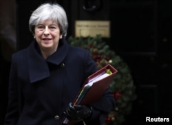 FILE - Britain's Prime Minister Theresa May leaves 10 Downing Street in London, Dec. 13, 2017.