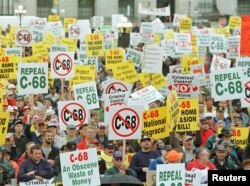 FILE - About 9,000 gun-owners, upset about the Liberals' attempt to create a national registry of all gun owners and their arms, rally on Parliament Hill to protest the Federal Government's tough new gun law, C-68, in Ottawa, Ontario, Canada, Sept. 22, 1998.
