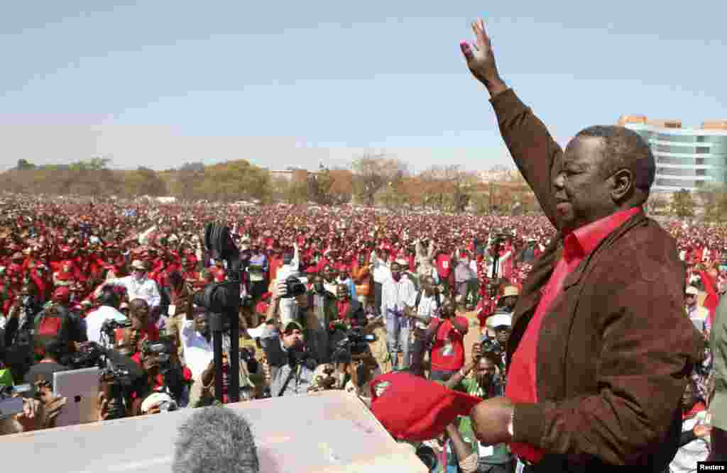 Leader of Zimbabwe's opposition party Movement For Democratic Change (MDC) Morgan Tsvangirai greets supporters at a rally in Harare, July 29, 2013.
