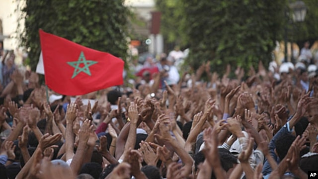 Protesters rally during a demonstration organized by the February 20 movement in Rabat, July 3, 2011.