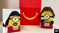 A cardboard McDonald's Happy Meal toy is shown with a Happy Meal box on Sept. 20, 2021.