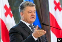 FILE - Ukrainian President Petro Poroshenko speaks at a press conference in Tbilisi, Georgia, July 18, 2017.