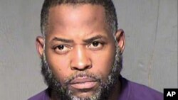 This undated law enforcement booking photo from the Maricopa County, Ariz., Sheriff's Department shows Abdul Malik Abdul Kareem.