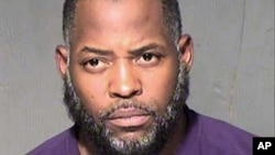 An undated law enforcement booking photo from the Maricopa County, Arizona, Sheriff's Department shows Abdul Malik Abdul Kareem. He is accused of hosting two gunmen at his home to discuss plans for a 2015 attack on a Prophet Mohammad cartoon contest in Texas.