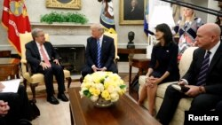 U.S. President Donald Trump, flanked by U.S. Ambassador to the United Nations Nikki Haley (2nd R) and National Security Adviser H.R. McMaster (R), delivers remarks to reporters as he welcomes United Nations Secretary General Antonio Guterres (L) for a mee