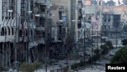 4일 시리아 정부군과 반군의 교전으로 홈스 지역 건물들이 상당 부분 파손돼 있다.