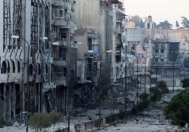 Destroyed buildings are seen on a deserted street in the besieged area of Homs, Syria, July 4, 2013.