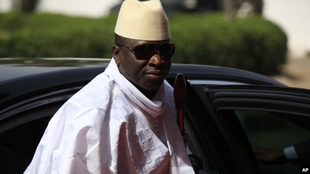 FILE- Gambia  President Yahya Jammeh arrives for a summit in Abuja, Nigeria, Feb. 27, 2015. The president fired three government ministers in a department reshuffle.