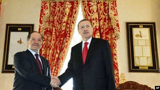 Turkish Prime Minister Tayyip Erdogan (R) and Kurdistan Region President Masoud Barzani shake hands before their meeting in Istanbul, April 19, 2012.