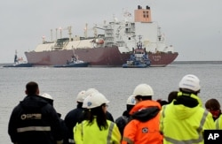FILE - The giant LNG ship Al Nuaman, which carries 200,000 cubic meters of liquefied gas, arrives in the Baltic port of Swinoujscie, Poland, Dec. 11, 2015, after 21 days of travel from Qatar.