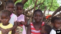 """One of the women of Tambacounda region of Senegal who took part this year in """"Operation Tabaski"""" with her children, 23 Nov 2009"""