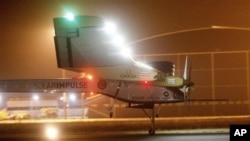 An experimental solar-powered plane, Solar Impulse, approaches to make a night landing at Rabat airport, Morocco, Tuesday, June 5, 2012 after a 20-hour trip from Madrid in the first transcontinental flight by a craft of its type. (AP Photo/Abdeljalil Boun