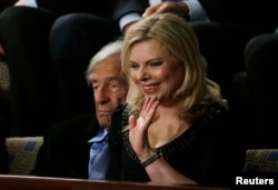 FILE - Sara Netanyahu, wife of Israeli Primine Minister Benjamin Netanyahu, waves while in the House Chamber, March 3, 2015.
