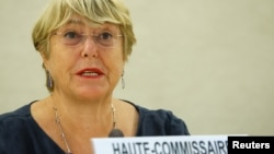 FILE - U.N. High Commissioner for Human Rights Michelle Bachelet attends a session of the Human Rights Council at the United Nations in Geneva, Switzerland, September 13, 2021.