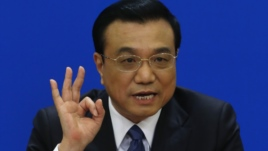 FILE - China's Premier Li Keqiang gestures as he speaks during a news conference, after the closing ceremony of the Chinese National People's Congress (NPC) at the Great Hall of the People, in Beijing, March 13, 2014.