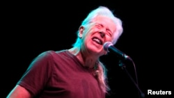 FILE - Blues legend John Mayall performs during a concert in Bucharest, Romania, Nov. 11, 2012.