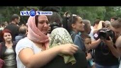 VOA60 DUNIYA: A Kasar Bosnia An Binne Gawarwakin Wasu Yan Kasar Su 136 Da Aka Gano, Yuli 09, 2015