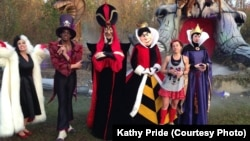 Kathy Pride poses with Disney characters after the Walt Disney World Marathon.