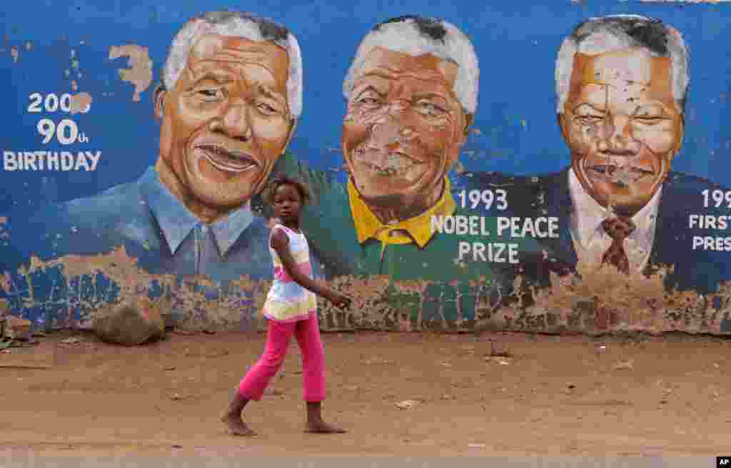 Portraits of Nelson Mandela depicted in various stages of his life in Soweto, South Africa, seen March 28, 2013.