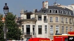 Firefighters are seen working on the roof of the Hotel Lambert, a 17th century mansion overlooking the Seine river, Paris, July 10, 2013.