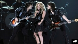 From left, Neil Perry, Kimberly Perry and Reid Perry, of musical group The Band Perry, perform at the 48th Annual Academy of Country Music Awards at the MGM Grand Garden Arena in Las Vegas, April 7, 2013.