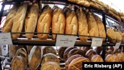 Loaves of sourdough bread are for sale are on display at Boudin at the Wharf at Fisherman's Wharf in San Francisco. (AP Photo/Eric Risberg)