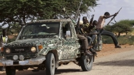 Fighters from the moderate Ahlu Sunna forces arrive at a road checkpoint outside Mareergur town, 30 km (19 miles) to the north of Dhusamareeb, in central Somalia Dec. 17, 2012. (Reuters)