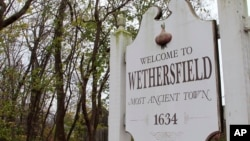 "In this Thursday, Nov. 15, 2018, photo a sign declares Wethersfield, Conn., the state's ""Most Ancient Town."" Experts have unearthed artifacts they believe date to the 1630s in Wethersfield, which has declared itself the state's ""most ancient town,"" founded in 1634."