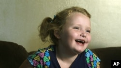 "Beauty pageant regular and reality show star Alana ""Honey Boo Boo"" Thompson gestures during an interview in her home in McIntyre, Ga, September 10, 2012."