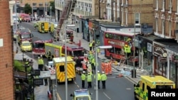 Emergency services respond to a bus crash in Lavender Hill, London, Aug. 10, 2017.