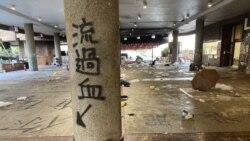 Hong Kong: Des centaines de manifestants cernés dans un campus par la police