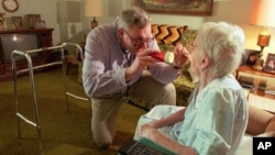 FILE - On a house call, Dr. Craig Krause examines a patient suffering from arthritis Thursday, March 9, 1995.