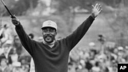 FILE - Charlie Sifford throws up his arms after he dropped a short par putt on the 18th green to tie Harold Henning of South Africa at the end of 72 holes in the $100,000 Los Angeles Open golf tournament, Sunday, Jan. 13, 1969.