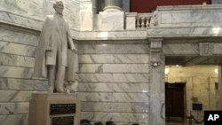 FILE - This July 20, 2017 file photo shows a statue of Jefferson Davis in the Kentucky Capitol in Frankfort, Ky. State officials are set to give an update on plans to remove a plaque from a statue of Jefferson Davis declaring him to be a patriot and a hero, Thursday, March 29, 2018.