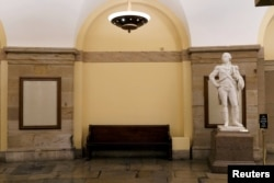 FILE - The spot in the U.S. Capitol where a statue of Confederate General Robert E. Lee had been, sits empty, after the monument was removed to be replaced with a statue of Black civil rights pioneer Barbara Johns, on Capitol Hill, Dec. 21, 2020.