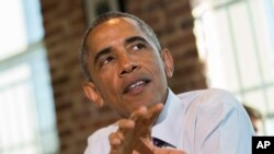 FILE - To enhance cybersecurity, President Barack Obama is calling for greater exchange of information among federal agencies and private companies.
