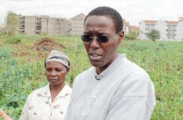 Mary Njenga, of Kenya's Urban Harvest NGO, with some of Nairobi's city farmers on their land near Kibera slum
