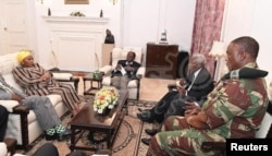 President Robert Mugabe, center, in a meeting with the ZDF Commander General Constantino Chiwenga, South African Minister of Defense Nosiviwe Mapisa-Nqakula (in yellow head wear), Zimbabwe Defense Minister Dr Sydney Sekeramayi and Zimbabwe State Security