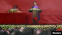 Burma's pro-democracy leader Aung San Suu Kyi delivers her speech at the National League for Democracy party's congress in Yangon March 10, 2013.