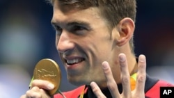 United States' Michael Phelps celebrates winning the gold medal in the men's 200-meter individual medley during the swimming competitions at the 2016 Summer Olympics, Aug. 11, 2016, in Rio de Janeiro, Brazil.